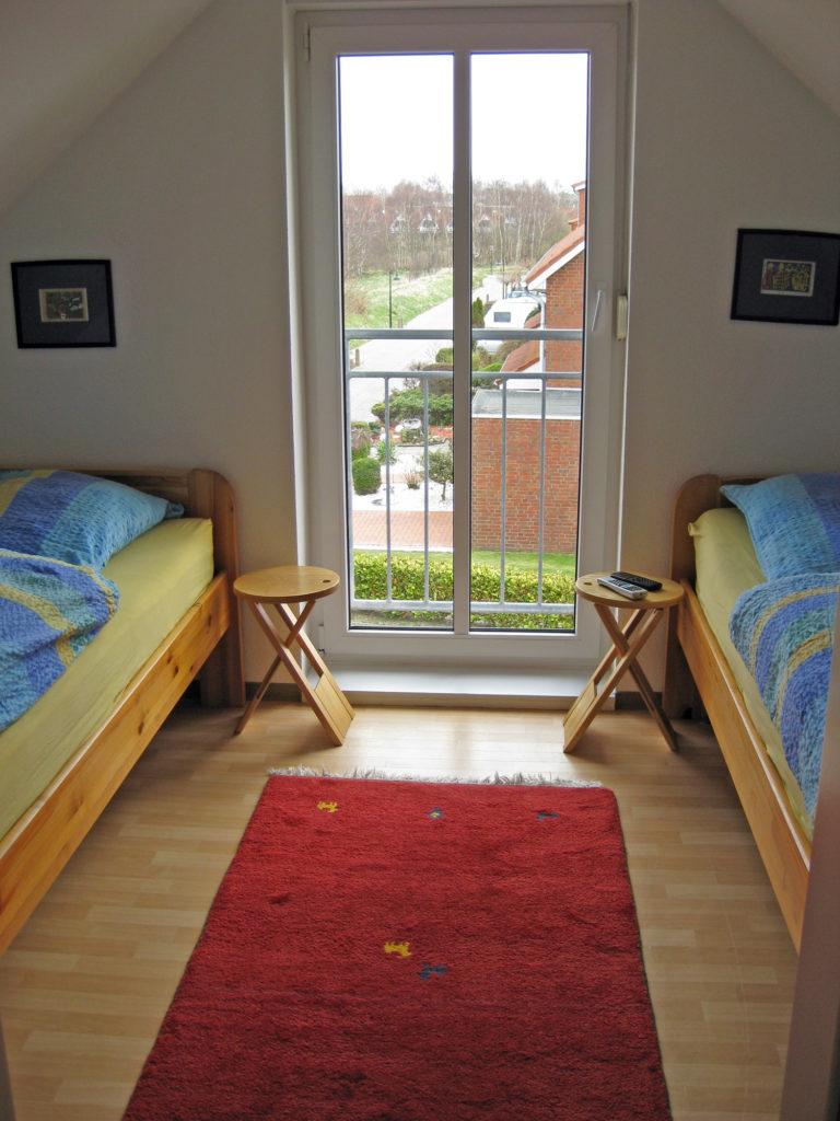 Schlafzimmer im Dachgeschoss - Ferienwohnung Rugenbargsweg Cuxhaven
